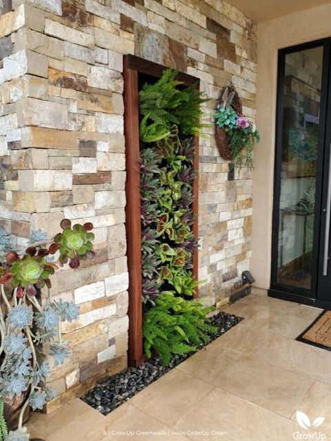 Small outdoor living wall framed into the wall