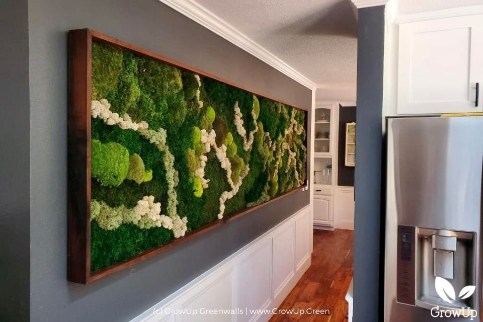 Long moss wall in the hallway of a home.
