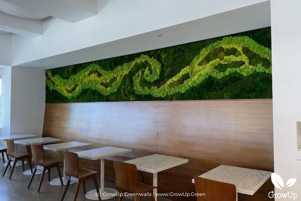 Large moss wall in a restaurant.